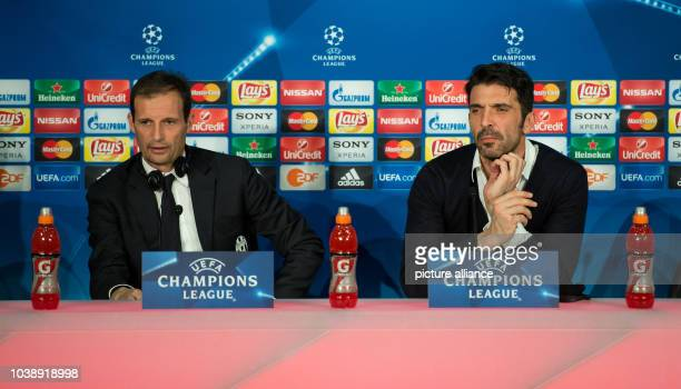 Juventus' head coach Massimiliano Allegri and goalkeeper Gianluigi Buffon attend a press conference of Juventus FC at the Allianz Arena in Munich...