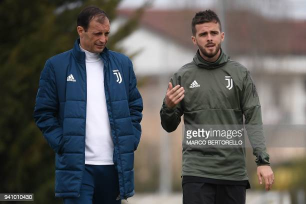 Juventus' head coach Massimiliano Allegri and Juventus' Bosnian midfielder Miralem Pjanic attend a training session on the eve of the UEFA Champions...