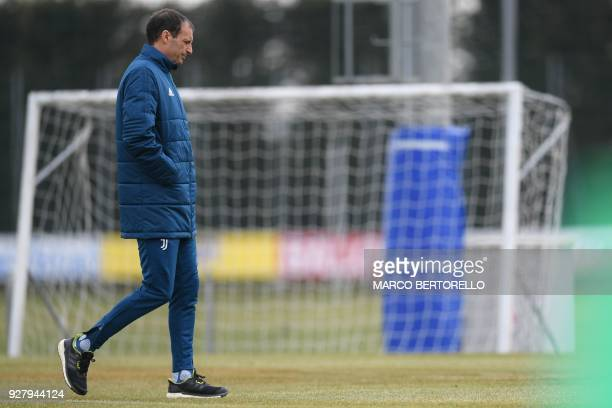 Juventus' head coach Massimiliano Allegri walks through the pitch during a training session on the eve of the UEFA Champions League football match...
