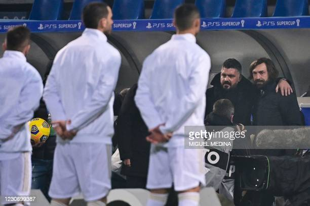 Juventus' Italian coach Andrea Pirlo and Napoli's Italian coach Gennaro Gattuso pose together prior to the Italian Super Cup football match between...