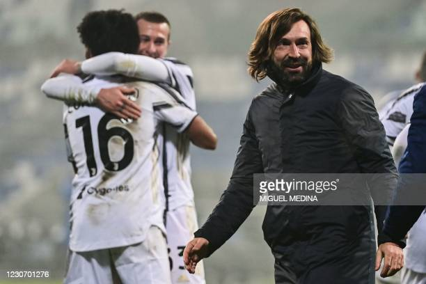 Juventus' Italian coach Andrea Pirlo celebrates at the end of the Italian Super Cup football match between Juventus and Napoli on January 20, 2021 at...