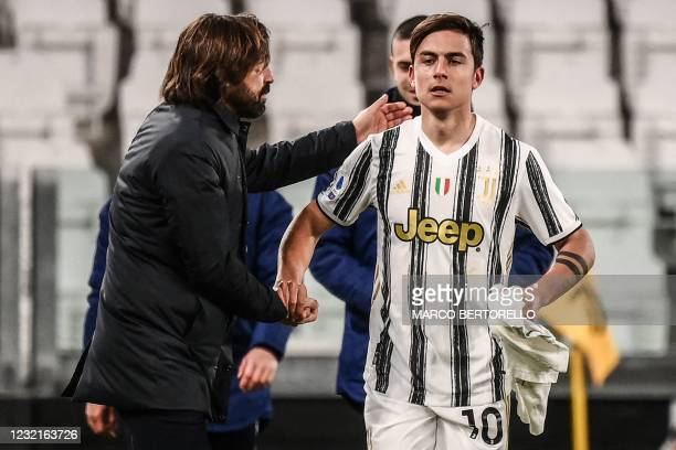 Juventus' Italian coach Andrea Pirlo congratulates Juventus' Argentine forward Paulo Dybala after he scored the second goal during the Italian Serie...