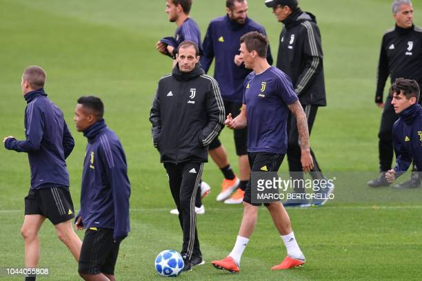Juventus' Italian coach Massimiliano Allegri and Juventus' Croatian forward Mario Mandzukic talk during a training session on the eve of the UEFA...