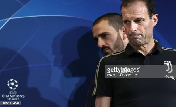 Juventus' Italian coach Massimiliano Allegri and Juventus' Italian defender Leonardo Bonucci arrive for a press conference at the Juventus Allianz...