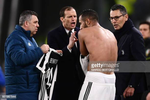 Juventus' Italian coach Massimiliano Allegri argues with Juventus' Moroccan defender Mehdi Amine Benatia after his tshirt was rippedup by Atalanta's...