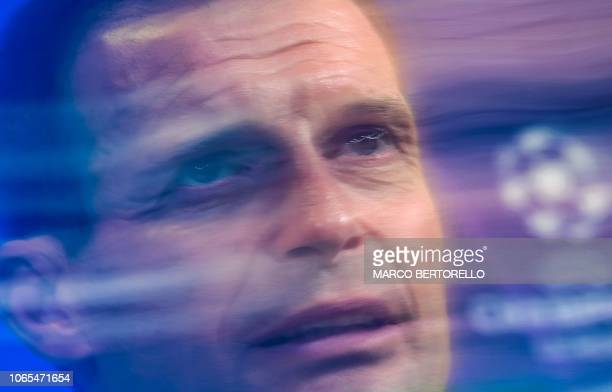 TOPSHOT Juventus' Italian coach Massimiliano Allegri attends a press conference on the eve of the UEFA Champions League group H football match...
