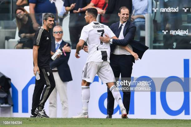 Juventus' Italian coach Massimiliano Allegri congratulates Juventus' Portuguese forward Cristiano Ronaldo after he scored his first goal since he...