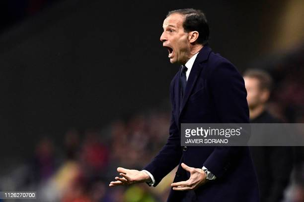 Juventus' Italian coach Massimiliano Allegri gestures during the UEFA Champions League round of 16 first leg football match between Club Atletico de...
