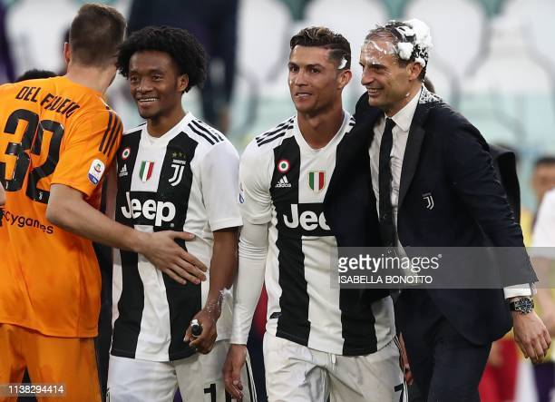 Juventus' Italian coach Massimiliano Allegri Juventus' Portuguese forward Cristiano Ronaldo both with their head covered in foam celebrate after...