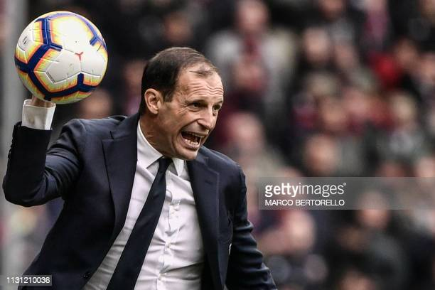Juventus' Italian coach Massimiliano Allegri reacts while throwing the ball back in play during the Italian Serie A football Match Genoa vs Juventus...