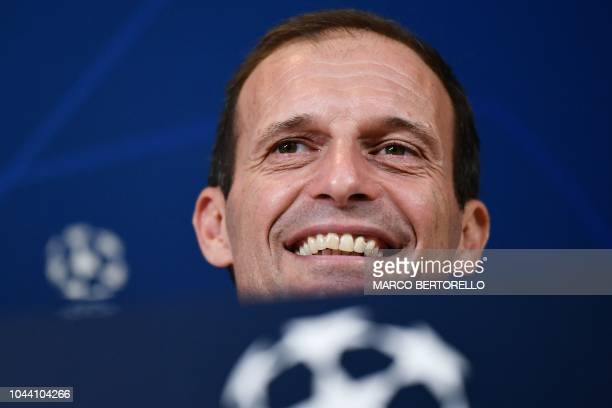 Juventus' Italian coach Massimiliano Allegri smiles during a press conference on the eve of the UEFA Champions League group H football match between...