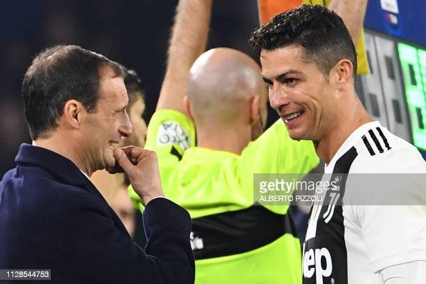Juventus' Italian coach Massimiliano Allegri speaks with Juventus' Portuguese forward Cristiano Ronaldo during the Italian Serie A football match...
