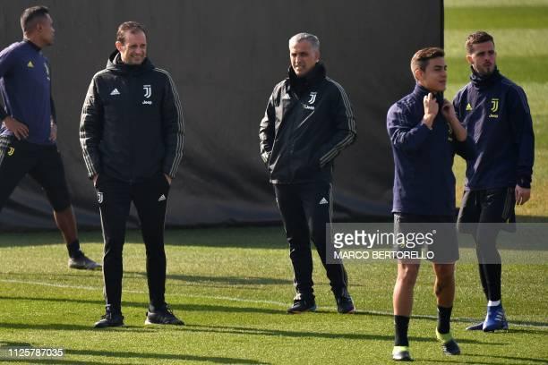 Juventus' Italian coach Massimiliano Allegri supervises a training session with Juventus' Argentine forward Paulo Dybala and Juventus' Bosnian...