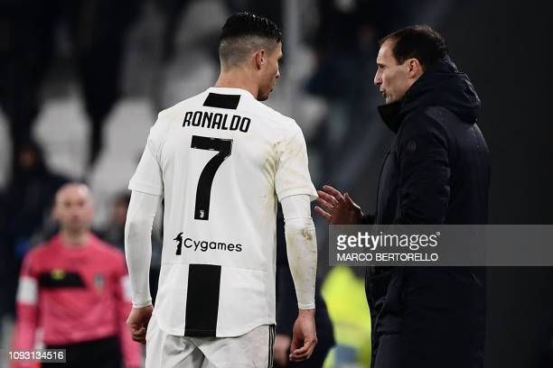 Juventus' Italian coach Massimiliano Allegri talks to Juventus' Portuguese forward Cristiano Ronaldo during the Italian Serie A football match...