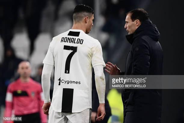 Juventus' Italian coach Massimiliano Allegri talks to Juventus' Portuguese forward Cristiano Ronaldo during the Italian Serie A football match...