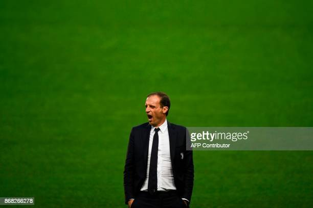 Juventus' Italian coach Massimiliano Allegri yawns on the pitch moments before a press conference at the Alvalade stadium in Lisbon on October 30...