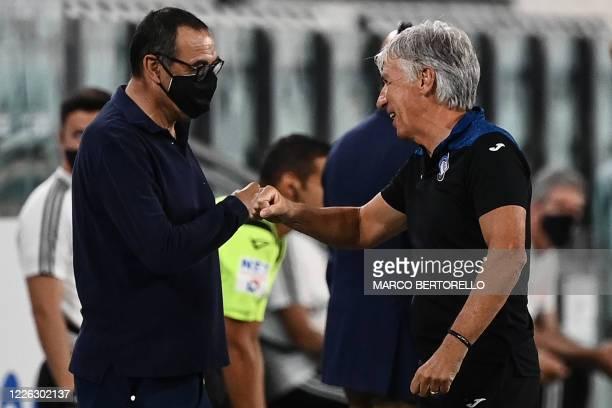 Juventus' Italian coach Maurizio Sarri and Atalanta's Italian head coach Gian Piero Gasperini tap hands prior to the Italian Serie A football match...