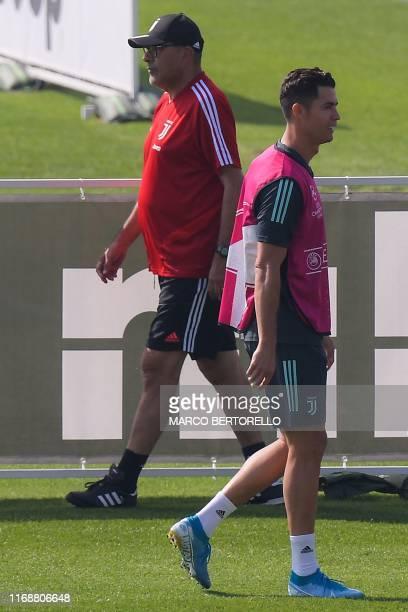 Juventus' Italian coach Maurizio Sarri and Juventus' Portuguese forward Cristiano Ronaldo attend a training session on September 17, 2019 at the...