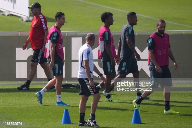 Juventus' Italian coach Maurizio Sarri, Juventus' Portuguese forward Cristiano Ronaldo, Juventus' Colombian midfielder Juan Cuadrado, Juventus'...