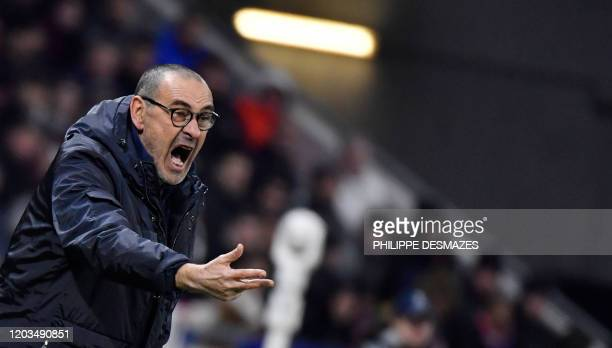 Juventus' Italian coach Maurizio Sarri shouts from the touch line during the UEFA Champions League round of 16 first-leg football match between Lyon...