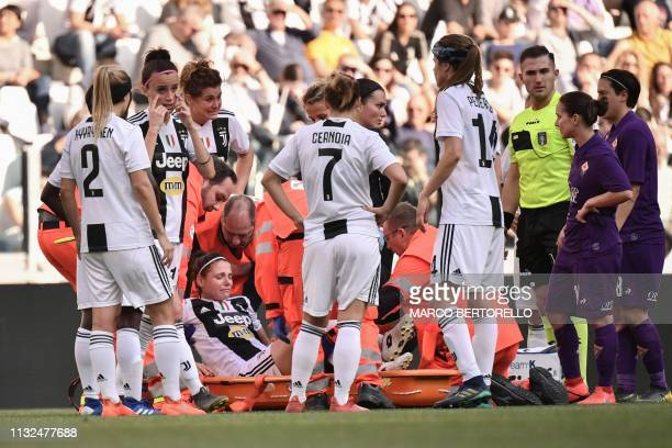 Juventus' Italian defender Cecilia Salvai is evacuated on a stretcher following injury during the Women's Serie A football match Juventus FC vs...