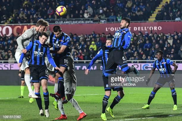 Juventus' Italian defender Daniele Rugani, Atalanta's Dutch midfielder Marten de Roon, Atalanta's Albanian defender Berat Djimsiti and Atalanta's...