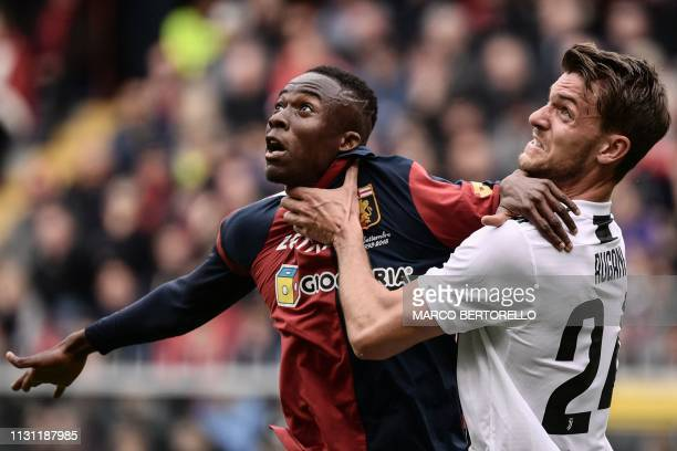 TOPSHOT Juventus' Italian defender Daniele Rugani holds Genoa's Italian forward Cristian Kouame's throat during the Italian Serie A football Match...