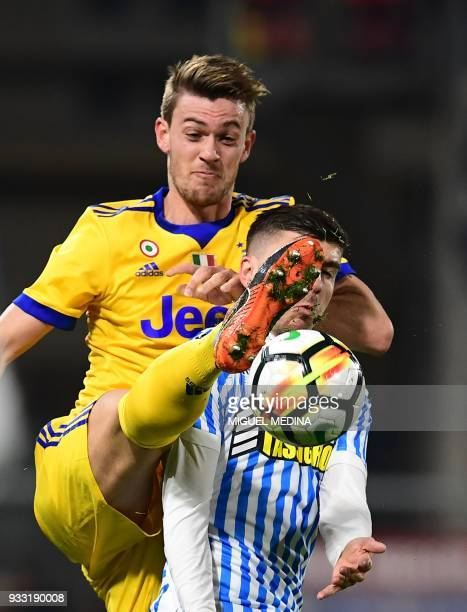 Juventus' Italian defender Daniele Rugani vies with Spal's Italian forward Alberto Paloschi during the Italian Serie A football match Spal vs...