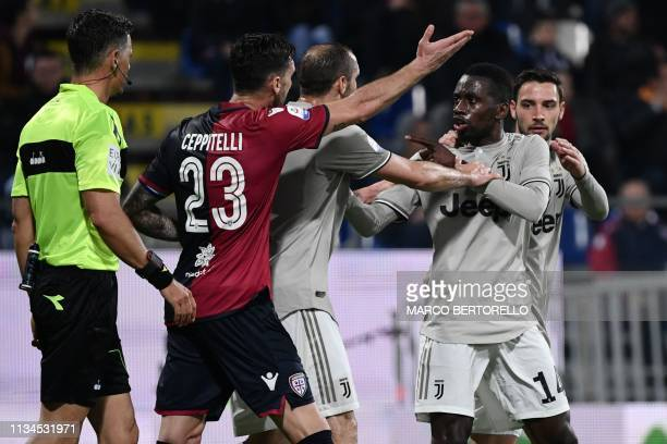 Juventus' Italian defender Giorgio Chiellini attempts to calm down Juventus' French midfielder Blaise Matuidi who reacted after Cagliari's fans...