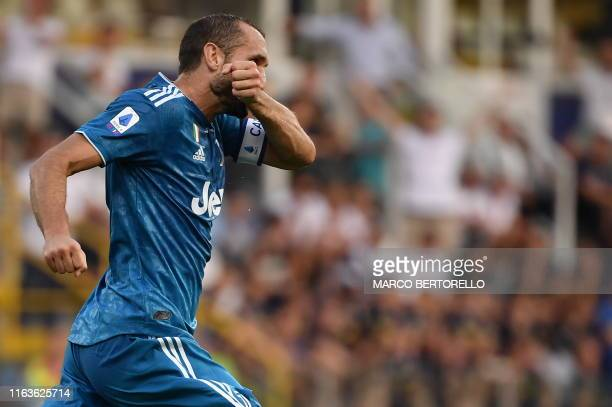 Juventus' Italian defender Giorgio Chiellini celebrates after opening the scoring during the Italian Serie A football match Parma vs Juventus on...