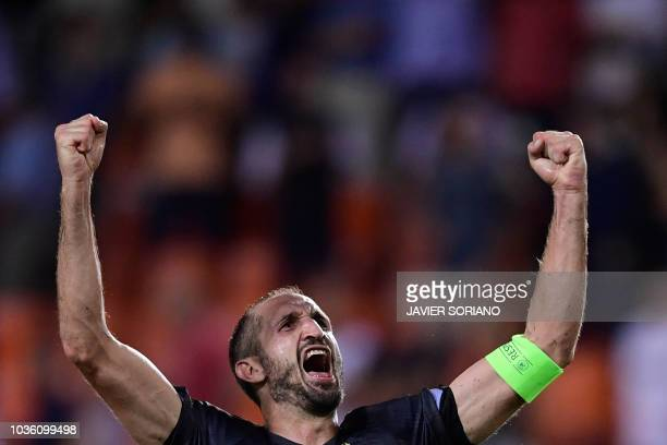 Juventus' Italian defender Giorgio Chiellini celebrates at the end of the UEFA Champions League group H football match between Valencia CF and...