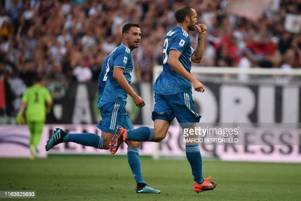 Juventus' Italian defender Giorgio Chiellini celebrates with Juventus' Italian defender Mattia De Sciglio after opening the scoring during the...
