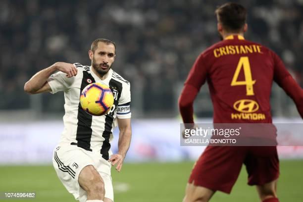 Juventus' Italian defender Giorgio Chiellini challenges AS Roma Italian midfielder Bryan Cristante during the Italian Serie A Football match Juventus...
