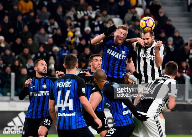 Juventus' Italian defender Giorgio Chiellini fights for the ball with Inter Milan's Slovakian defender Milan Skriniar during the Italian Serie A...