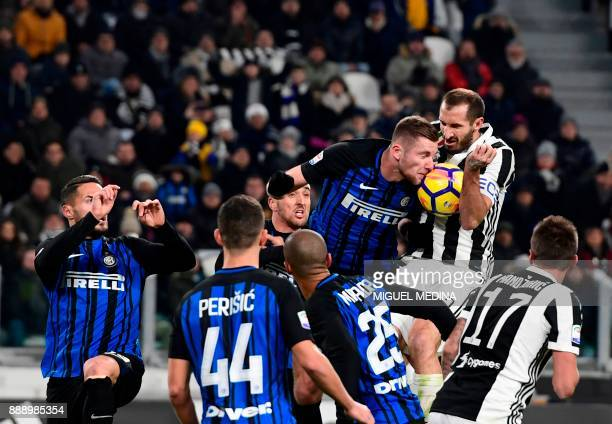 TOPSHOT Juventus' Italian defender Giorgio Chiellini fights for the ball with Inter Milan's Slovakian defender Milan Skriniar during the Italian...