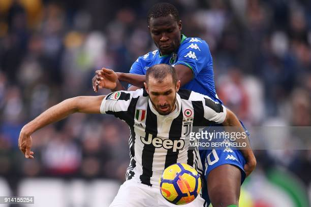 Juventus' Italian defender Giorgio Chiellini fights for the ball with Sassuolo's Senegalese defender Khouma Babacar during the Italian Serie A...