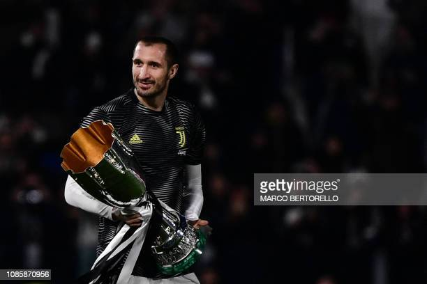 Juventus' Italian defender Giorgio Chiellini holds the the Supercoppa Italiana prior to the Italian Serie A football match Juventus vs Chievo Verona...