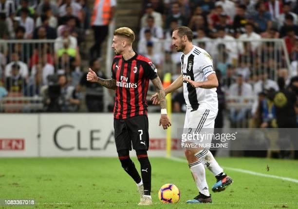 Juventus' Italian defender Giorgio Chiellini is marked by AC Milan's Spanish forward Samuel Castillejo during their Supercoppa Italiana final between...