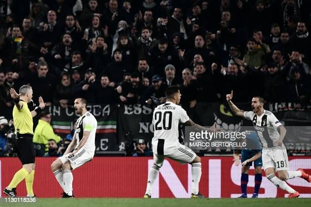 Juventus' Italian defender Giorgio Chiellini , Juventus' Portuguese defender Joao Cancelo and Juventus' Italian defender Leonardo Bonucci contest...