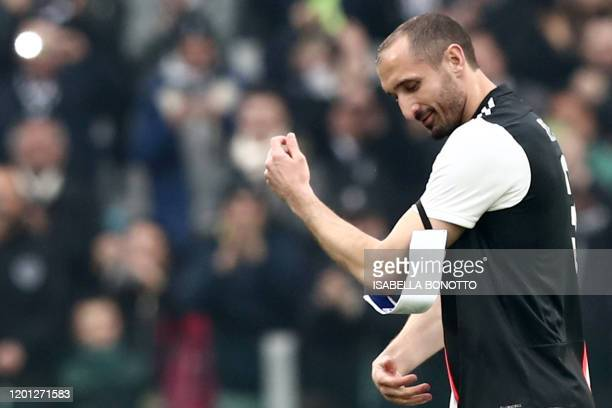 Juventus' Italian defender Giorgio Chiellini puts on the captain's armband after entering the pitch during the Italian Serie A football match...