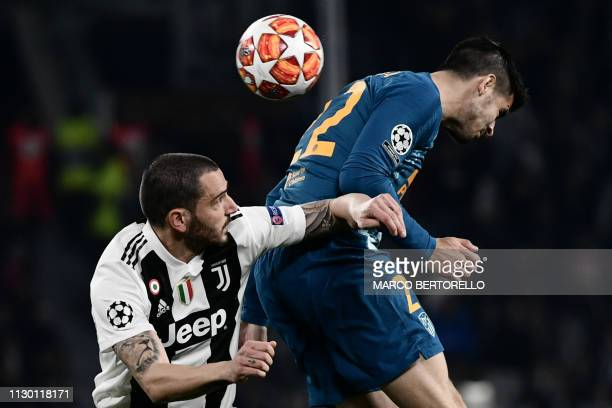 Juventus' Italian defender Leonardo Bonucci and Atletico Madrid's Spanish forward Alvaro Morata go for a header during the UEFA Champions League...