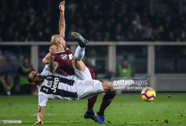 Juventus' Italian defender Leonardo Bonucci and Torino's Italian forward Simone Zaza go for the ball during the Italian Serie A football match Torino...