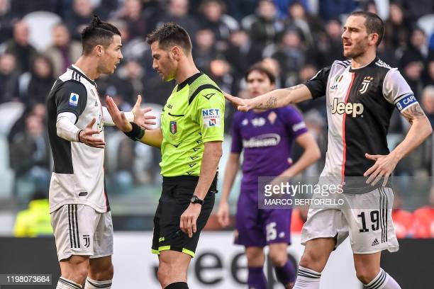 Juventus' Italian defender Leonardo Bonucci arrives as Juventus' Portuguese forward Cristiano Ronaldo argues with Italian referee Fabrizio Pasqua...