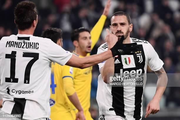 Juventus' Italian defender Leonardo Bonucci celebrates with Juventus' Croatian forward Mario Mandzukic after scoring during the Italian Serie A...