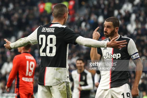 Juventus' Italian defender Leonardo Bonucci celebrates with Juventus' Turkish defender Merih Demiral after scoring during the Italian Serie A...