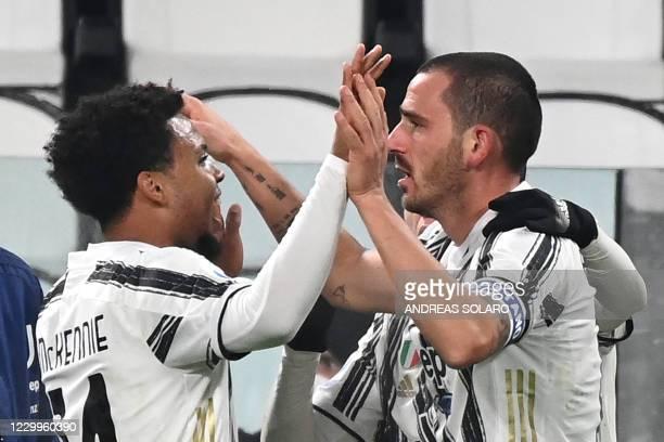 Juventus' Italian defender Leonardo Bonucci celebrates with Juventus' American midfielder Weston McKennie after scoring a goal during the Italian...
