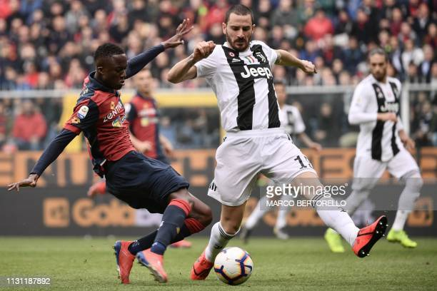 Juventus' Italian defender Leonardo Bonucci defends against Genoa's Italian forward Cristian Kouame during the Italian Serie A football Match Genoa...
