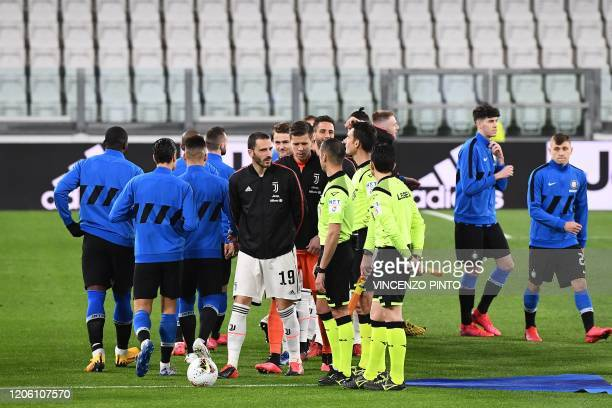 Juventus' Italian defender Leonardo Bonucci greets referees without shaking hands due to the novel coronavirus before the Italian Serie A football...