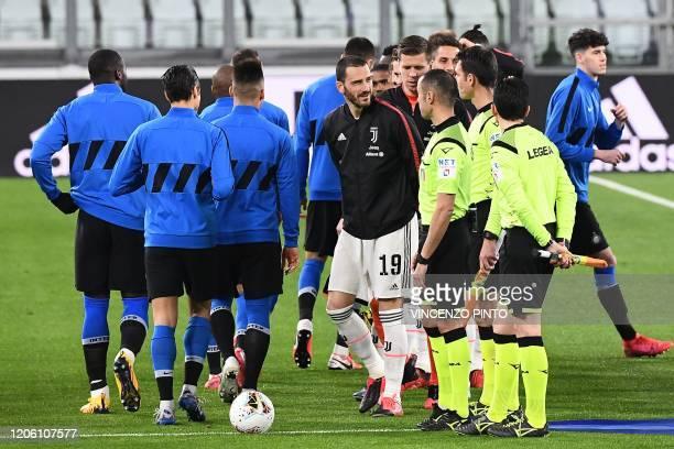 Juventus' Italian defender Leonardo Bonucci greets referees without shaking hands due to the novel coronavirus before the Italian Serie A football...