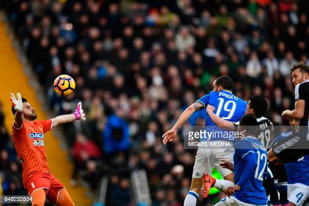 Juventus' Italian defender Leonardo Bonucci heads to score during the Italian Serie A football match Udinese vs Juventus at the Dacia Arena Stadium...